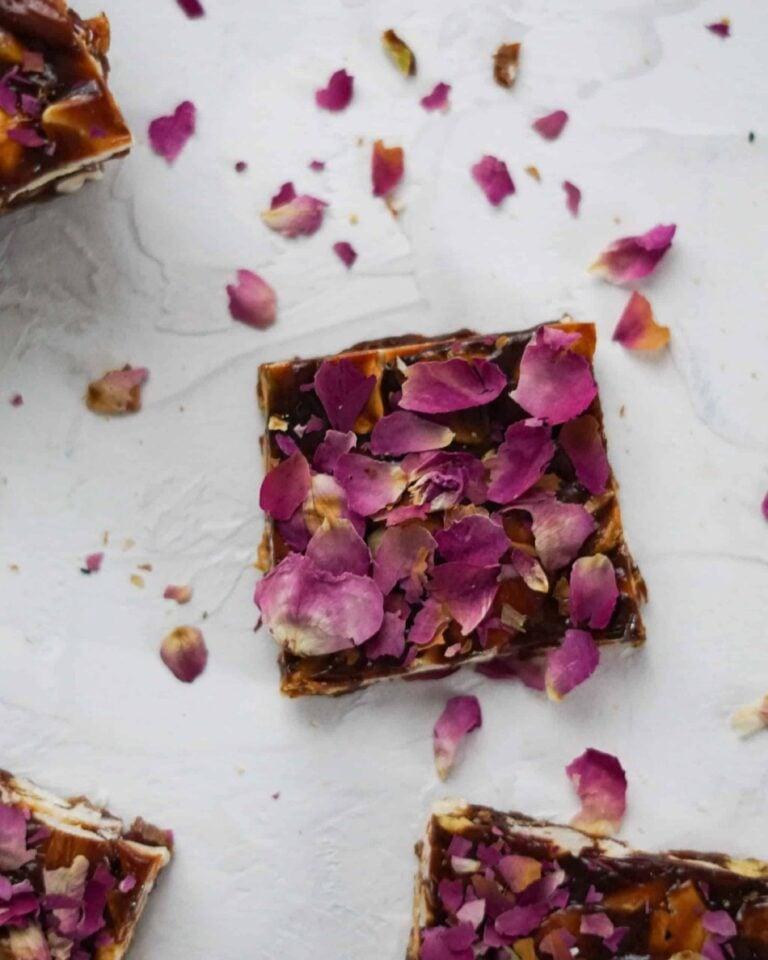 rose chikki piece with rose petals for garnish
