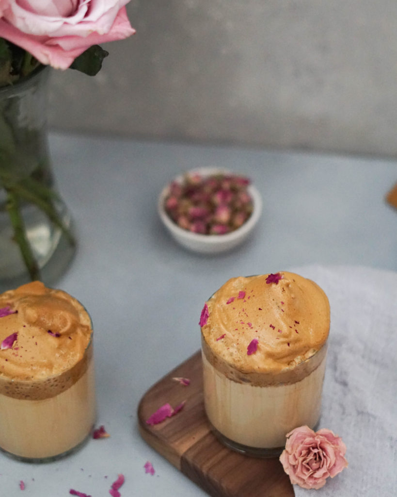 rose dalgona coffee with rose petals