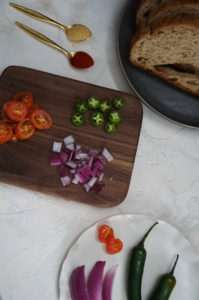 Chopped tomatoes, jalapenos, red onion and sourdough bread