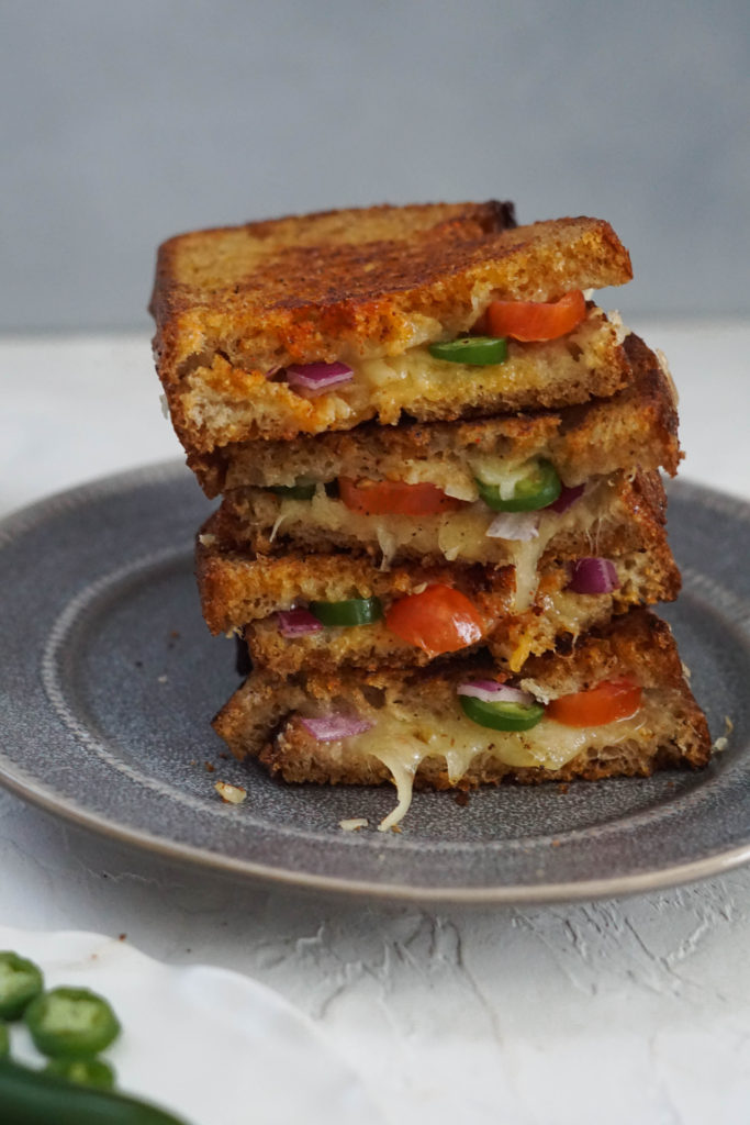 Spicy inside out grilled cheese Stacked grilled cheese with jalapenos, onions and tomatoes