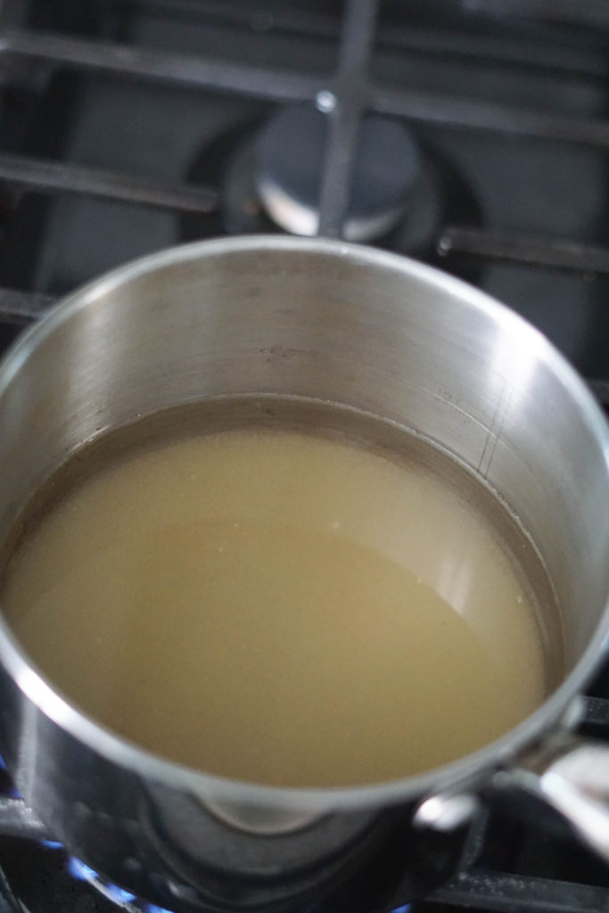 sugar and water in pan boiling
