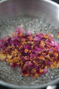 Sugar water boiling with rose petals