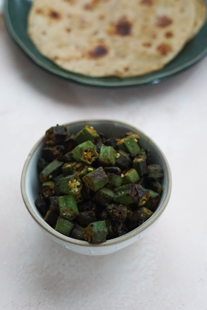 Bhinda nu shaak, an Indian okra recipe. Okra cooked and spiced in a bowl.