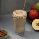 smoothie in a glass with apples and cinnamon