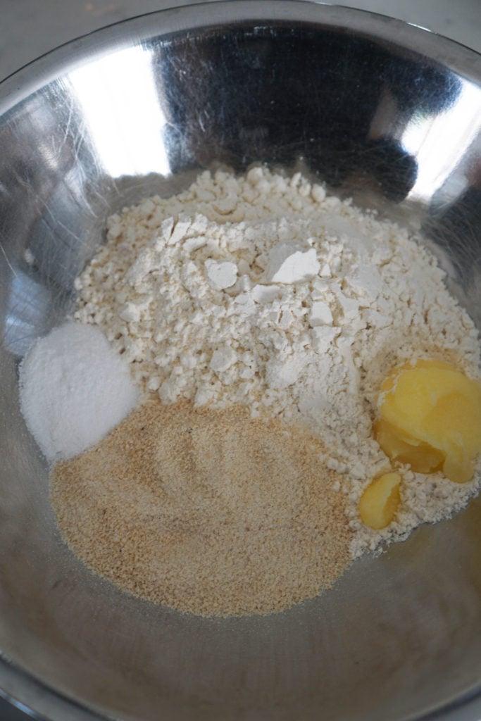 jalebi ingredients in a steel bowl.