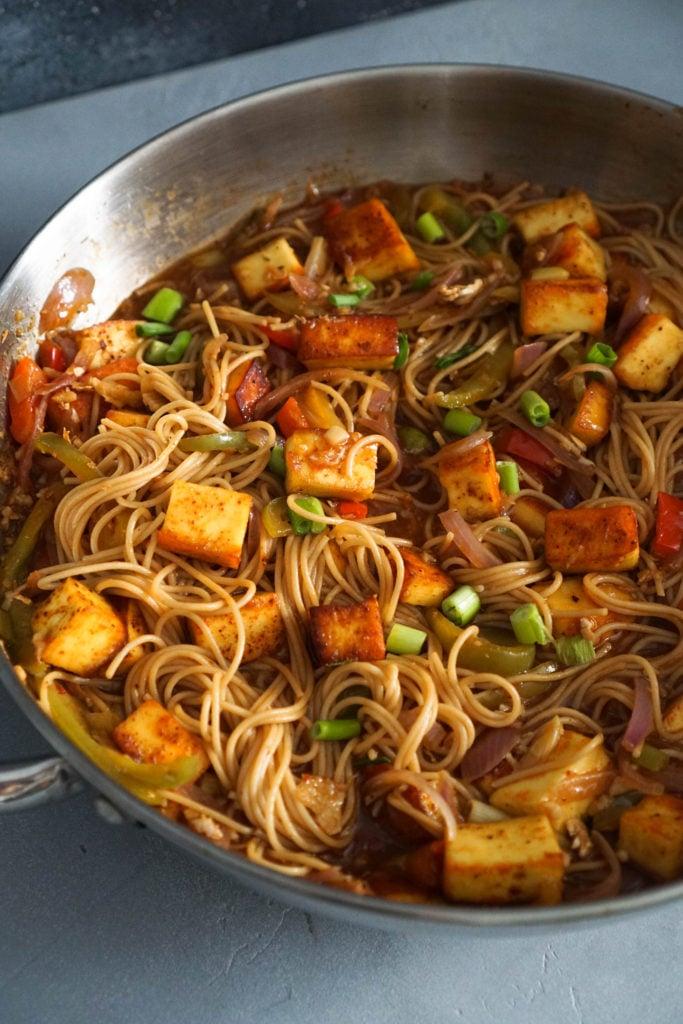 chilli paneer noodles in wok