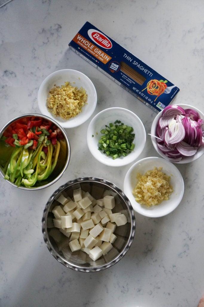 Chilli paneer ingredients on marble top.