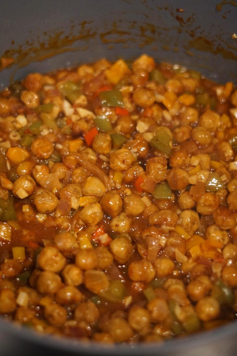crispy chana chick peas into spicy veg sauce