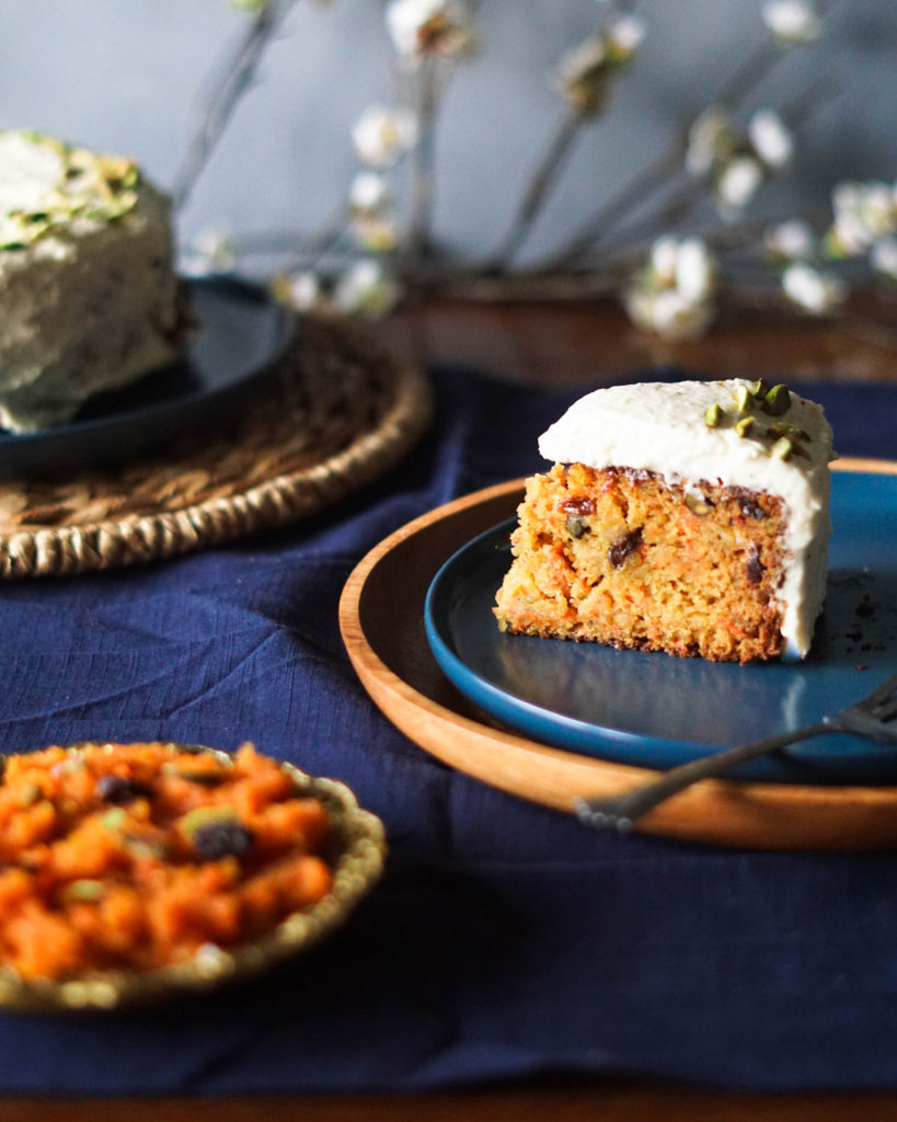 indian carrot cake slice on blue plates with carrot halwa on side