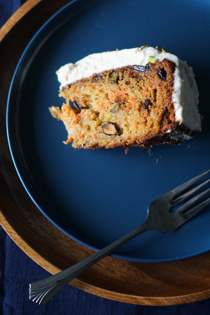 indian carrot cake on blue plate and silver fork