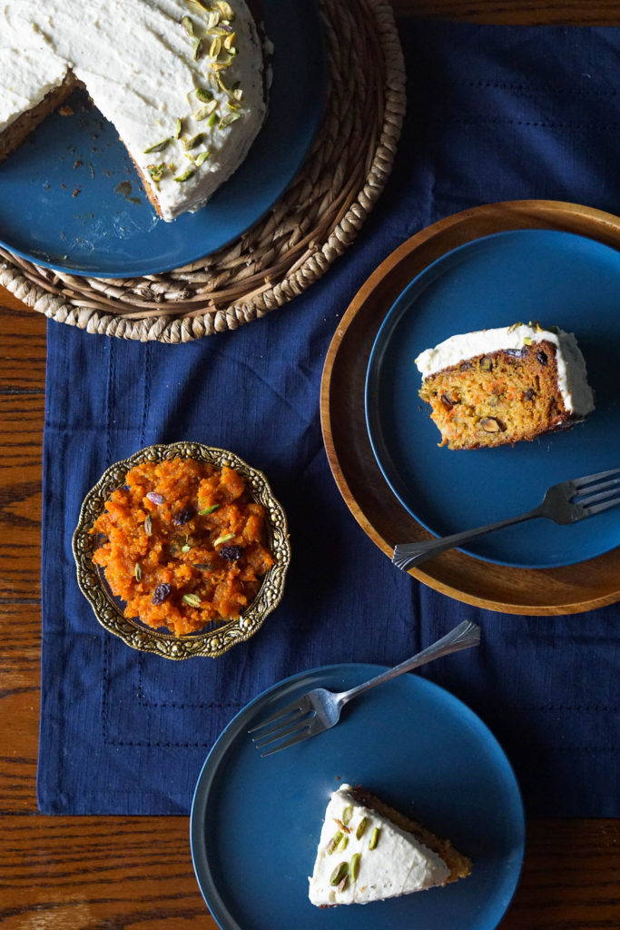 gajar ka halwa and indian carrot cake on blue plates on a wooden table