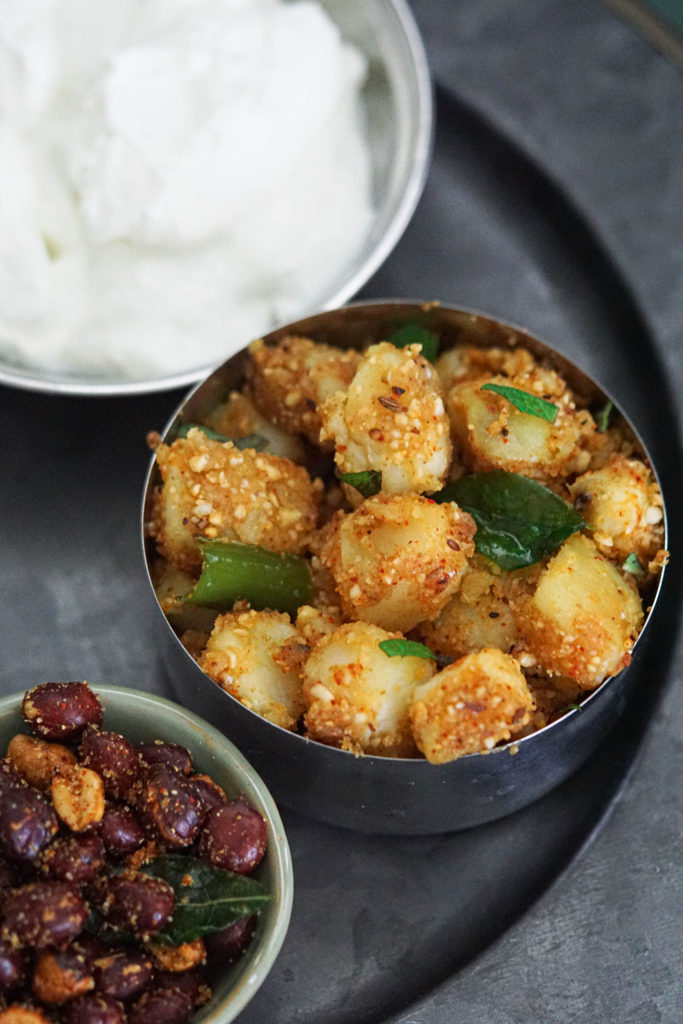 Sukhi bhaji served with farali accompaniments of yogurt and masala peanuts.