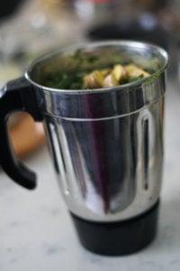 Cilantro chutney ingredients in a blender