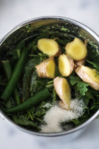 Mint pudina chutney ingredients in a blender