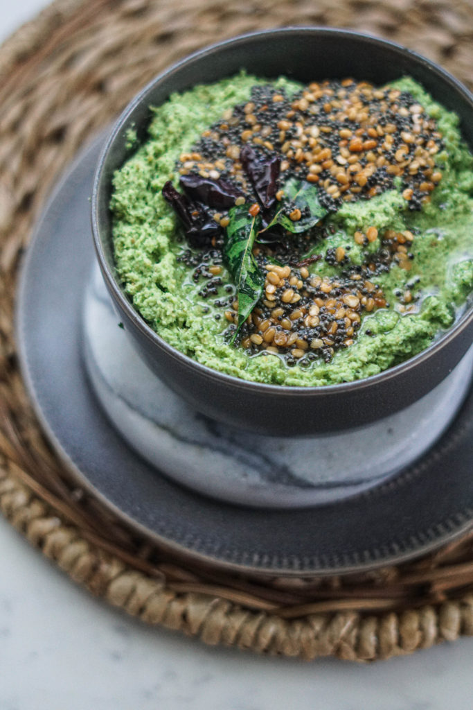 Green cilantro coconut chutney with vaghar or tadka poured on top