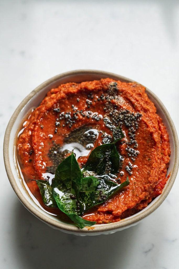 Tadka on top of garlic tomato chutney