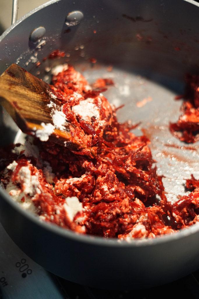 Add cardamom, milk powder and sugar to shredded beets
