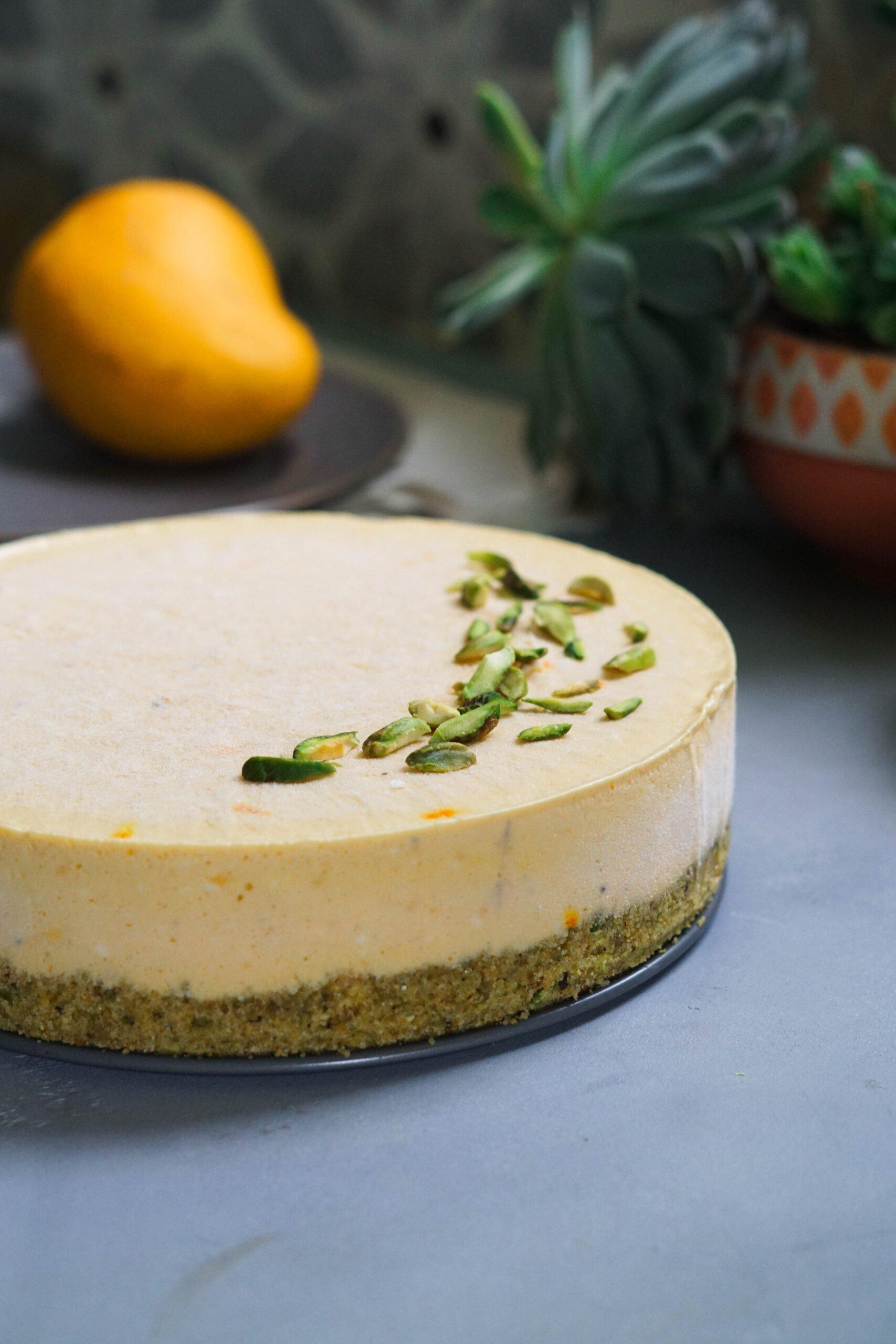 eggless mango shrikhand cheesecake with pistaschio garnish