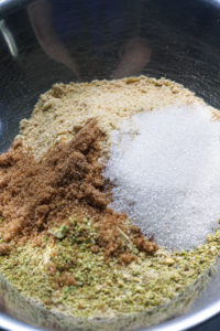 Pistachio cracker crust for cheesecake ingredients in a bowl