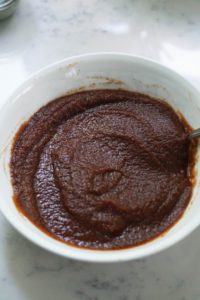 Apple butter chutney in a white bowl.