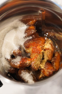 Ingredients for khajoor ki chutney (salt, sugar,dates, spices)in a blender.