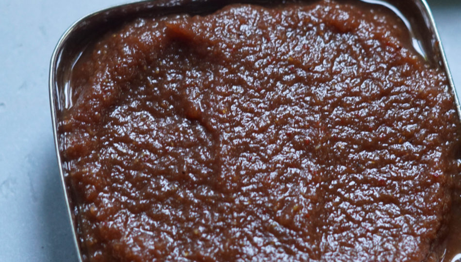 Apple butter chutney in a square small bowl.