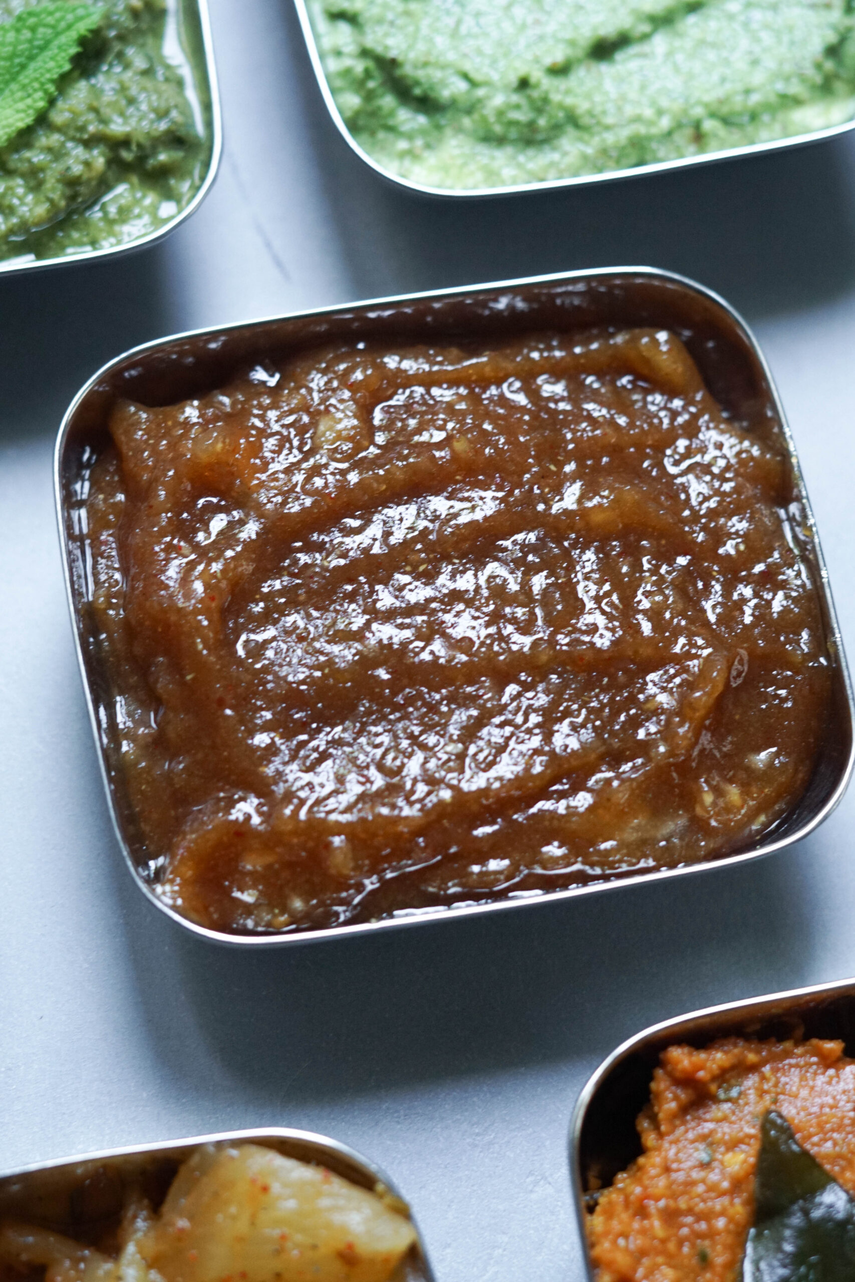 sweet dates chutney in a square steel bowl