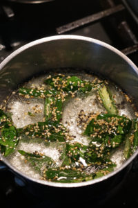Water and khaman tadka in a pot with sugar boiling.