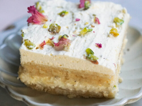 Ras Malai Cake slice on a fluted white plate