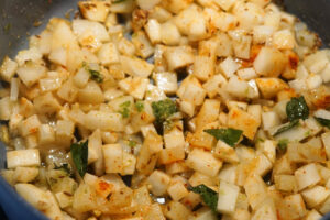 Cooked potatoes in a pan with spices.
